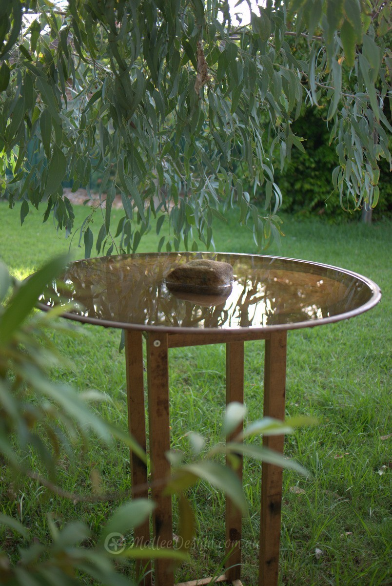 Steel Floating Bird Bath: This Stand Is Designed To Disappear Into The  Plants In A Garden Bed. It Is Made Up Of Three Thin Metal Rods That Taper  And Attach ...